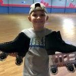 Michael holding his custom roller skates