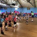 Denise teaching kids to skate at Sky-Vue Skateland