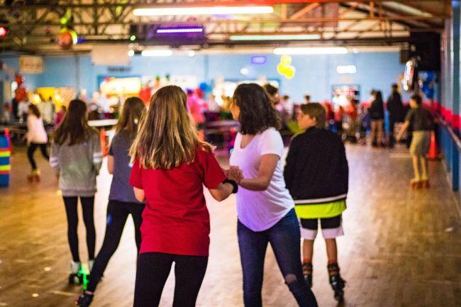 Teens skating at Sky-Vue Skateland